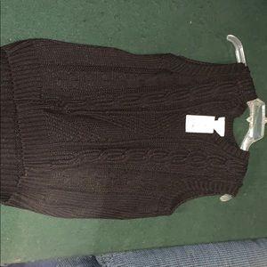 Sleeveless black sweater
